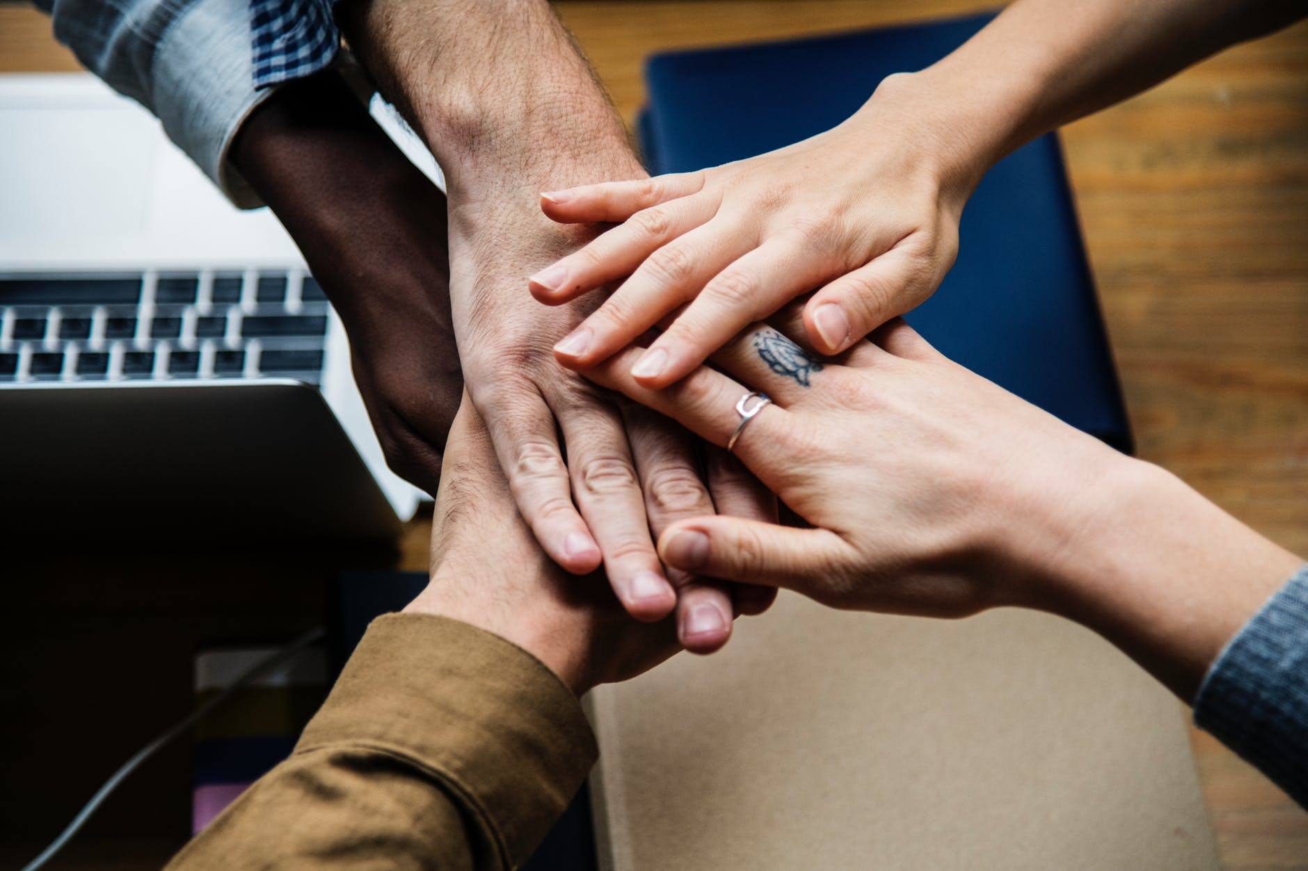 five person holding hands together